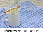white ceramic glass and wooden... | Shutterstock . vector #403204849