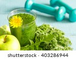 green smoothie with dandelion... | Shutterstock . vector #403286944