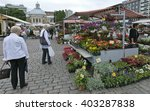 Small photo of TURKU, ABO FINLAND ON JUNE 29. View of outdoor stands at a Market in the City on June 29, 2013 in Turku, Abo Finland. Flowers and flowerpots. Unidentified people.