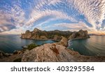 Sunset over the bay of the Black Sea, the Crimean peninsula, beautiful landscape with mountain