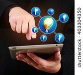 businessman holding a tablet... | Shutterstock . vector #403304350