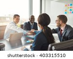 Small photo of Successful multiracial business team working together affirm their commitment by linking hands across an office table during a meeting