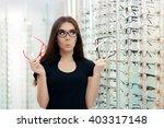 woman choosing eyeglasses... | Shutterstock . vector #403317148