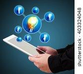 businessman holding a tablet... | Shutterstock . vector #403324048