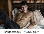 shirtless sexy male model lying ... | Shutterstock . vector #403335874