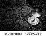 retro compass on road texture... | Shutterstock . vector #403391359
