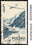 Small photo of SINGAPORE - APRIL 10, 2016: A stamp printed in Poland to commemorate Airmail Service shows Jantar Glider, circa 1976.