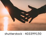 couple hands reach silhouette... | Shutterstock . vector #403399150