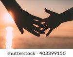 couple hands reach silhouette... | Shutterstock . vector #403399150