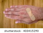band aid plaster applied to a... | Shutterstock . vector #403415290