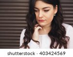 sad young woman deep in... | Shutterstock . vector #403424569