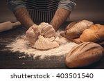 male hands knead the dough. | Shutterstock . vector #403501540