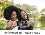 afro women taking selfie photos ... | Shutterstock . vector #403547689