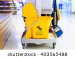 yellow mop bucket and set of...   Shutterstock . vector #403565488