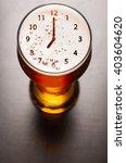 clock symbol on foam in beer... | Shutterstock . vector #403604620