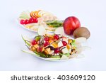 delicious salad of mixed fruit | Shutterstock . vector #403609120
