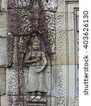 apsara bas relief in the temple ...   Shutterstock . vector #403626130