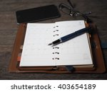 pocketbook anf fountain pen   Shutterstock . vector #403654189