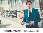 confident young car dealer... | Shutterstock . vector #403662310
