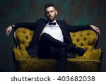 stylish young man in a suit and ... | Shutterstock . vector #403682038