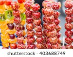 sugar coated haws on a stick | Shutterstock . vector #403688749
