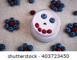 blueberry yogurt with a smiling ... | Shutterstock . vector #403723450