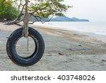 Tire Swing Under Tree On Ocean...
