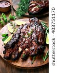 barbecue pork ribs on wooden... | Shutterstock . vector #403751170