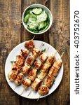 chicken kebabs and cucumber...   Shutterstock . vector #403752670