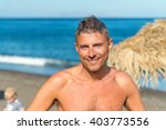 happy man relaxing on a... | Shutterstock . vector #403773556