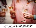 pouring white wine into glass... | Shutterstock . vector #403801948