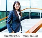 portrait of a smiling business... | Shutterstock . vector #403846363