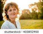 outdoor portrait of mature... | Shutterstock . vector #403852900