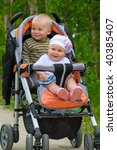 Two Children In Baby Carriage....
