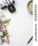 desk with coffee and flowers | Shutterstock . vector #403898524