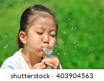 girl with dandelion fluff | Shutterstock . vector #403904563