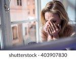 Woman Sitting On Windowsill ...