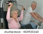 senior couple exercising in gym | Shutterstock . vector #403920160