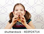 hungry little girl eating tacos | Shutterstock . vector #403924714