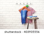 male clothes on hangers in a... | Shutterstock . vector #403935556