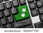 Stock photo close up view on conceptual keyboard green key with dog footprints symbol 403947790
