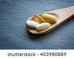 healthy supplements on wooden... | Shutterstock . vector #403980889