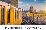 Stock photo panoramic view of berliner u bahn with oberbaum bridge in the background in golden evening light at 403996540