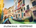 traditional gondolas on narrow...   Shutterstock . vector #403998460