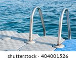 Stainless steel hand rails of a swimmers