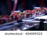 strawberries on conveyor belt... | Shutterstock . vector #404009323