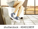 blue shoes and sofa and woman... | Shutterstock . vector #404013859
