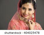 beautiful indian woman in... | Shutterstock . vector #404025478