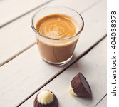 two chocolates candies and cup... | Shutterstock . vector #404038378