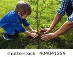 little boy helping his father... | Shutterstock . vector #404041339
